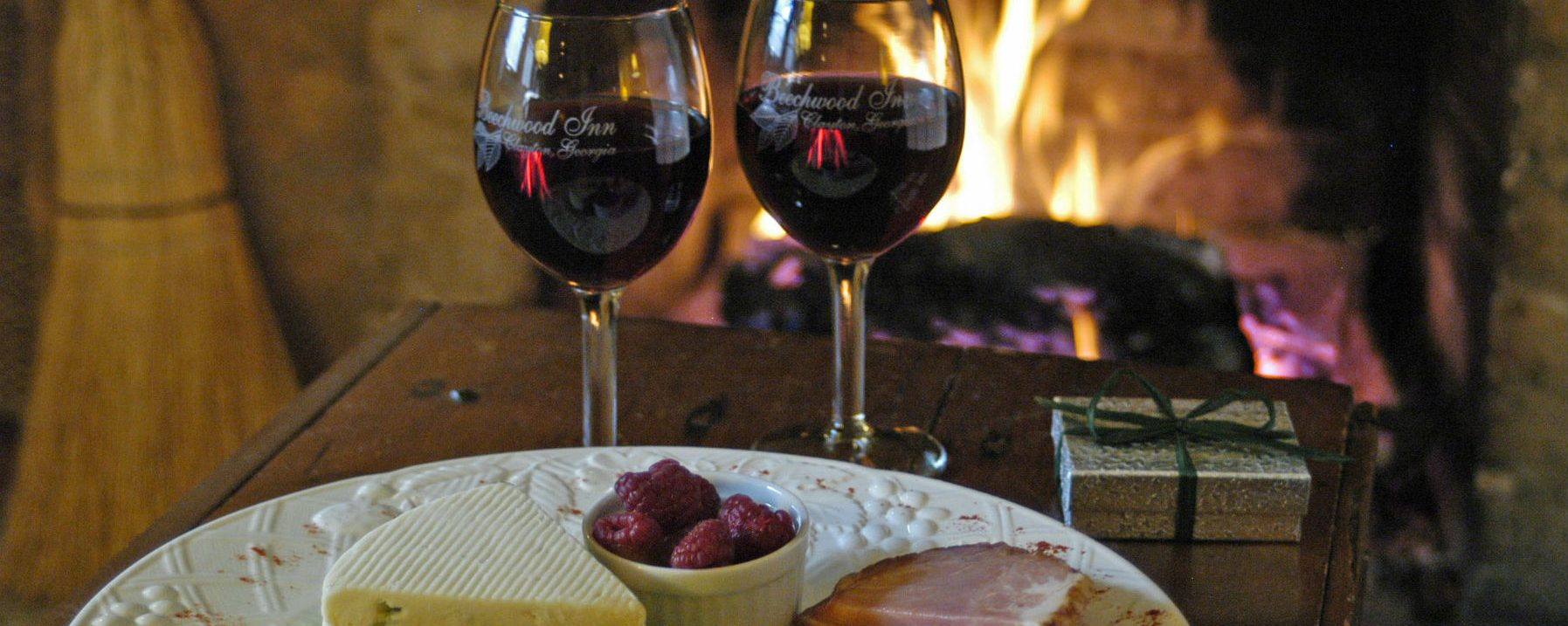 Image of Wine and Cheese at Beechwood Inn in front of a fire, warm and cozy